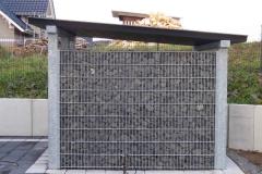 hier wurde ein Holzschuppen in Gabionentechnik erstellt - ein Schmuckstück für das Grundstück